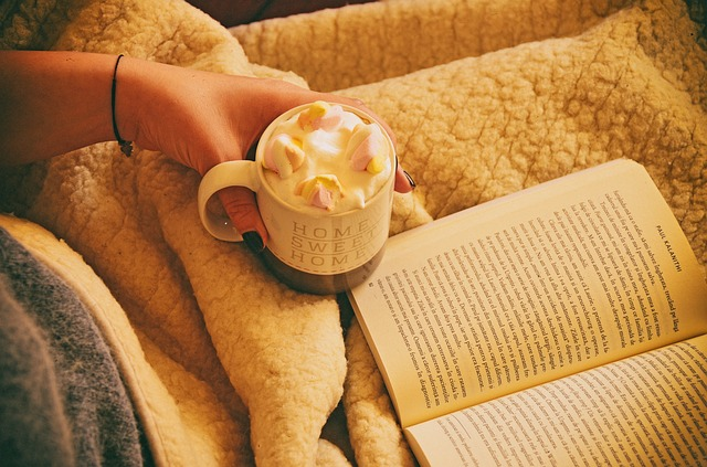 The perfect place to read women's fiction, cosy, warm, cup of coffee